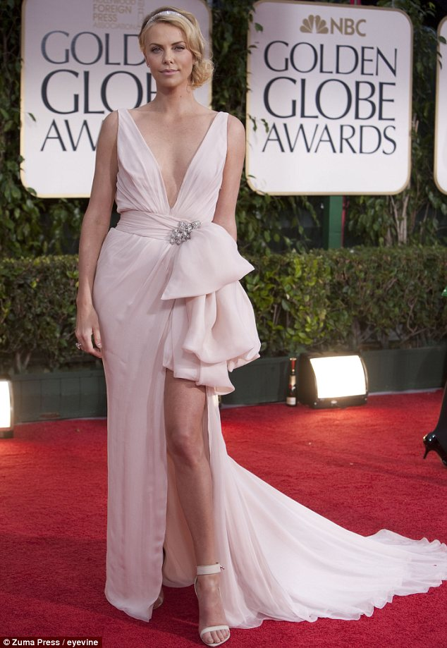 J'adore Dior: Charlize's current look is a far cry from her red carpet ready look. Seen here in a Dior dress at the Golden Globe awards