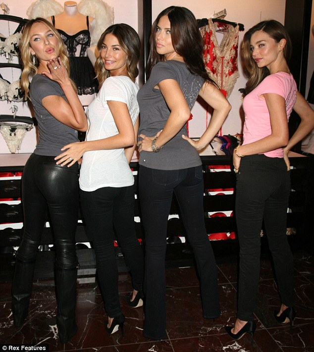 Show offs: Miranda stood out next to fellow models Candie Swanepoel, Lily Aldridge and Adriana Lima at the photo call, seen here in black jeans and a pink top