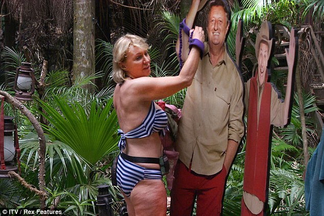 Bullseye buds: Nadine Dorries fastens herself to a cardboard cut out of Eric Bristow