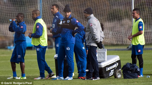 What happens next? QPR's players take a breather during Monday's training session
