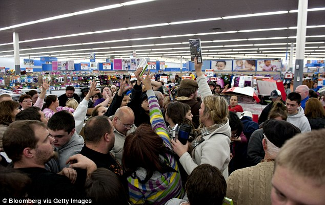 Crazed consumers: Shoppers vie for copies of video games at a Black Friday sale at a Walmart store in Mentor, Ohio in 2011