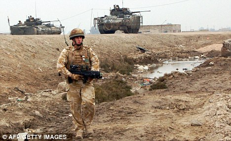 Iraq: A British soldier in the southern Iraqi city of Basra. The Qarmat Ali water plant, which the RAF servicemen guarded, is close to the city