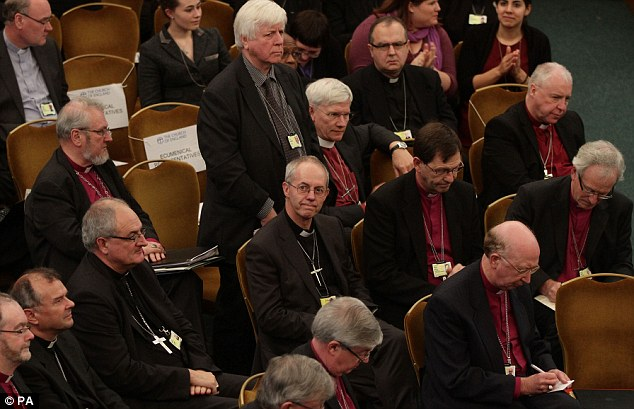Disappointment: Rt Rev Justin Welby (centre), at the meeting of the General Synod. He had campaigned for a 'yes' vote
