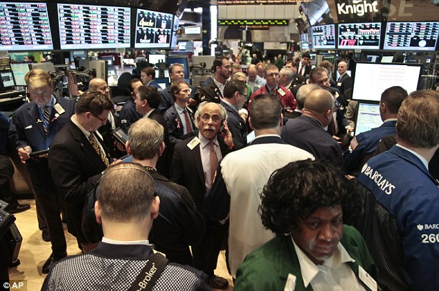 Watching the drop: Traders at the New York Stock Exchange today as Hewlett-Packard stock suffered a huge decline after it accused Autonomy staff of misleading the company about its finances