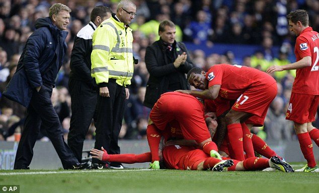 Mock: Suarez celebrated in front of Moyes after the Everton boss accused him of simulation