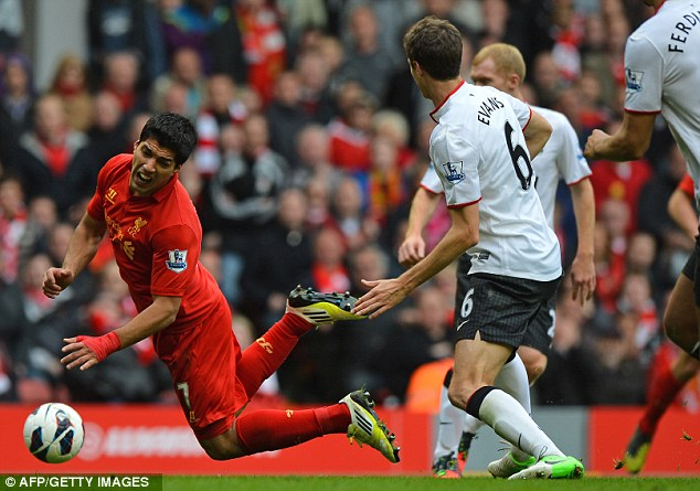 Saint and sinner: Luis Suarez has been accused of diving during his time at Liverpool