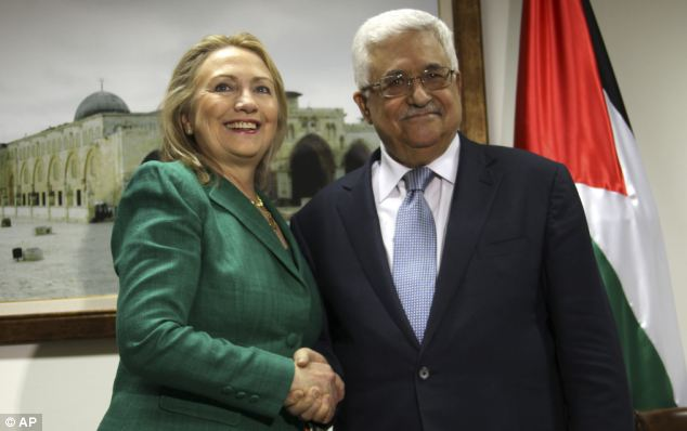 Broker: U.S. Secretary of State Hillary Clinton, left, shakes hands with Palestinian President Mahmoud Abbas during a meeting in the West Bank city of Ramallah. Mrs Clinton made the visit to try and broker a peace deal