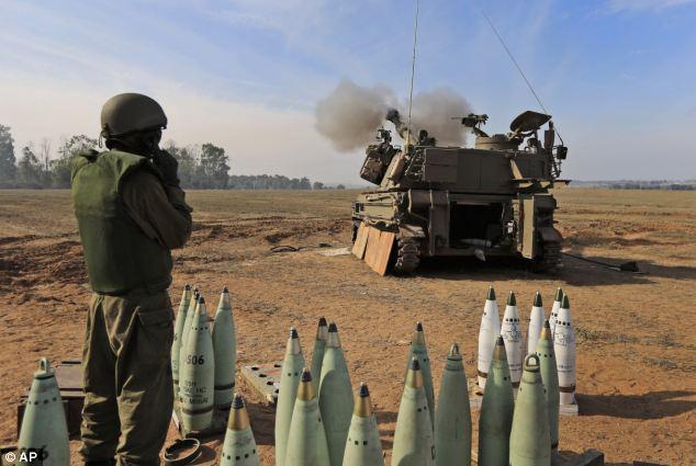 Israeli army artillery unit fires shells near the Israel Gaza Strip Border
