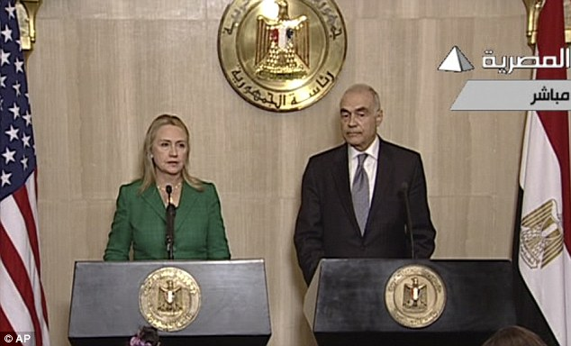 Ceasefire: In this image from Egyptian State Television, U.S. Secretary of State Hillary Rodham Clinton, left, and Egyptian Foreign Minister Mohammed Kamel Amr, right,  announce the cease-fire between Israel and Hamas