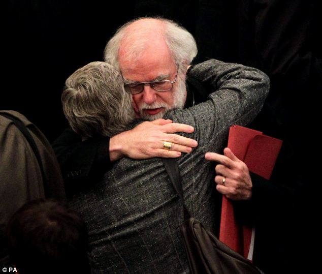 Hopes dashed: Dr Rowan Williams, the outgoing Archbishop of Canterbury, comforts a colleague. He had also campaigned for legislation approving women bishops