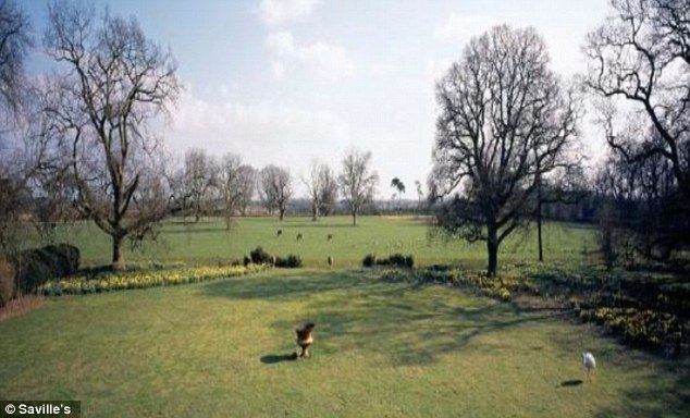 70 acres of grounds with private woodland, paddocks, a swimming pool, four cottages and a lodge.