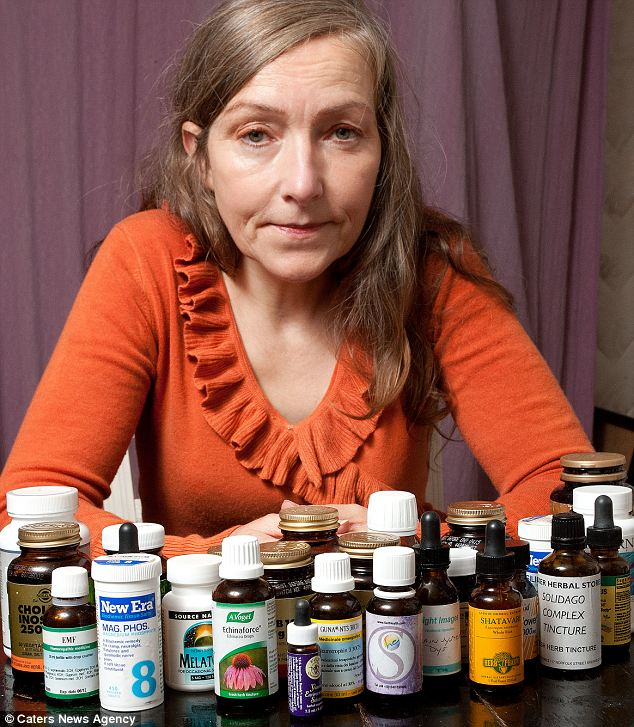 Velma at home with all the supplements she takes every day