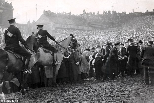 Mounted police take charge at Burnden Park while casualties are removed from an overcrowded match between Bolton Wanderers and Stoke