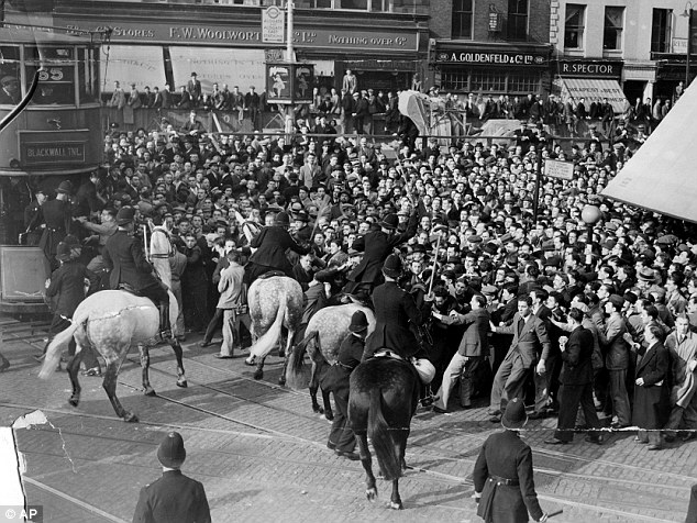 Police horses control a crowd during riots at Gardiner's Corner East London in 1936