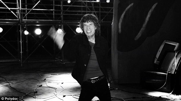 Moves like Jagger: Mick thrusts his aging hips around in black and white whilst screaming out anti-capitalist lyrics