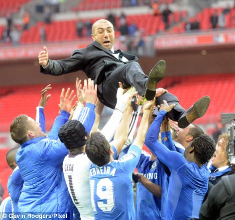 How the mighty have fallen: Di Matteo celebrates with the team after the FA Cup final