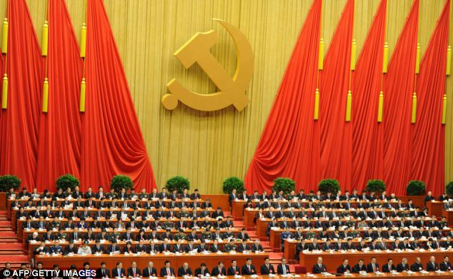 New generation of leaders: Delegates listen as Chinese President Hu Jintao delivers his address at the opening of the 18th Communist Party Congress