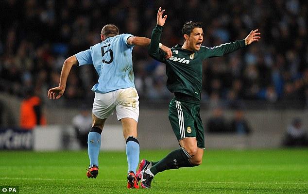 Get off! Ronaldo throws himself to the floor after Zabaleta tugs his shirt