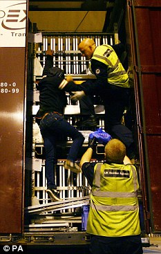 Failed bid: UK Border Agency staff remove a man hidden in a lorry in the French port of Calais