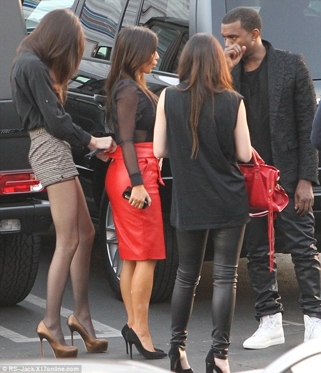 Oops! Before they headed into the studios, Kendall helped her sister Kim, who appeared to be suffering from a wardrobe malfunction