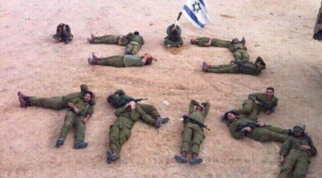 Battle-hungry: To show their frustration, 16 Israeli Defence Force soldiers arranged their uniformed bodies on the sand, to spell out the Hebrew words 'Bibi loser' in a deft physical critique of Prime Minister Benjamin (Bibi) Netanyahu