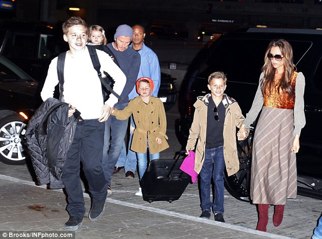 Leading the pack: The 13-year-old, who is growing up fast, was seen leading the way into LAX