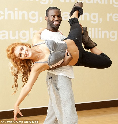 Just like a pro: Muamba lifts Miss Vilani in training