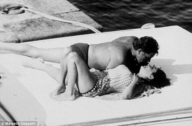 The real deal: Liz and Richard seen in an iconic photograph from June 1962 when they were snapped by paparazzi on a boat off the coast of Ischia in the Bay of Naples
