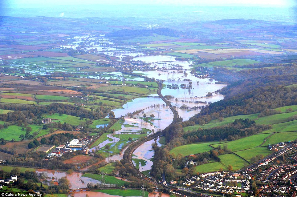 Britain under water: Aerial pictures of severe flooding across the South West of England where the Environment Agency have issued 29 flood warnings and 45 flood alerts