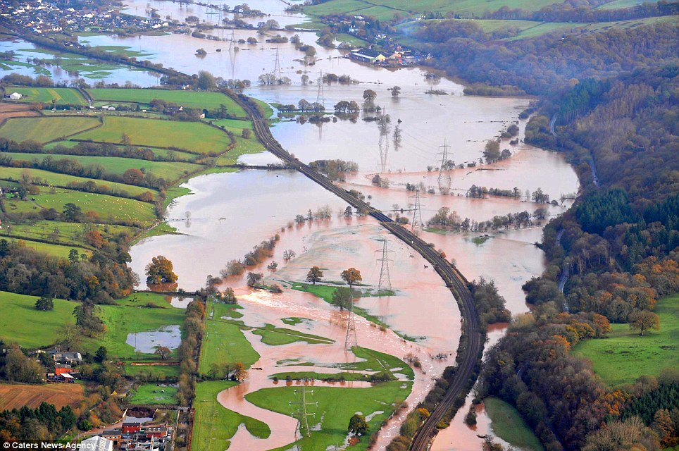 A track through the floods: A train line can be seen running through Exeter as the surrounding fields are submerged under water