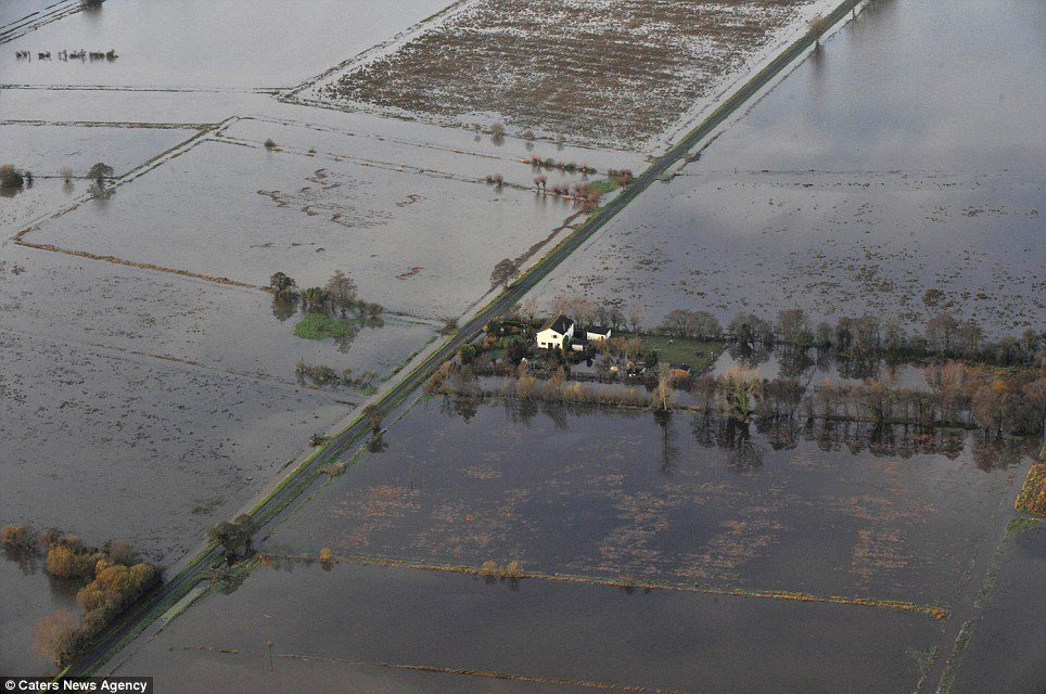 Cut off: A single house is seen on the Somerset Levels surrounded by flooded fields
