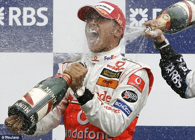 Maiden victory: Hamilton celebrates becoming the first black driver to win a grand prix