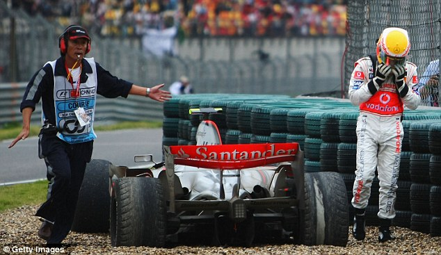 Blow: Hamilton retires from the 2007 Chinese Grand Prix after losing control of his McLaren in the wet conditions