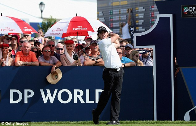 Share the joy: Rory McIroy is in a three-way tie at the top of the leaderboard