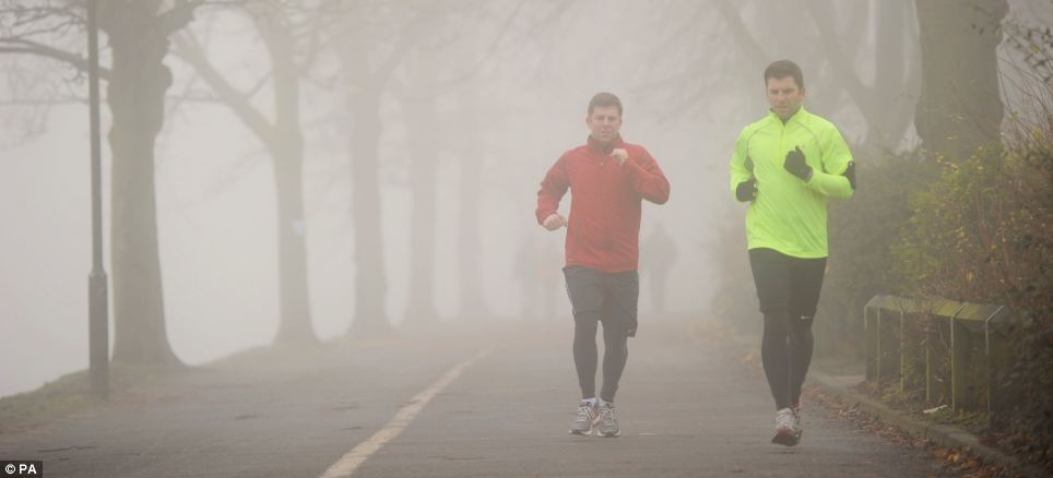 Runners in the mist and fog of York, North Yorkshire, this morning