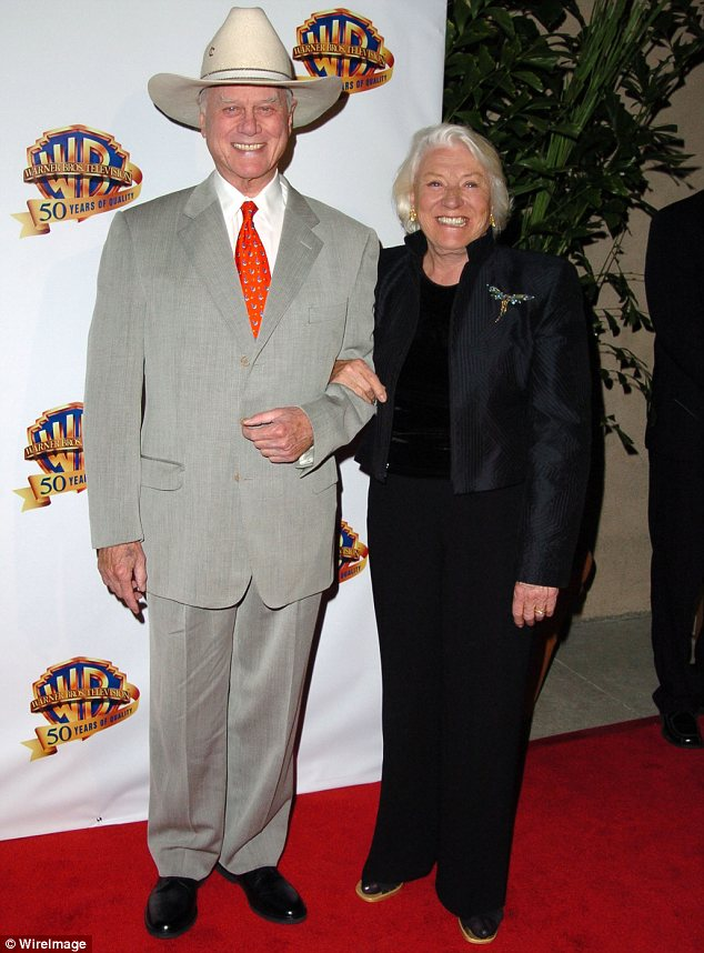 Man and wife: Larry's wife Maj, who he married in 1954, was diagnosed with Alzheimer's Disease in 2008. She is seen with him in 2005