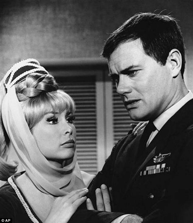 This 1967 photo shows Barbara Eden, left, and Larry Hagman in a scene from the television show I Dream of Jeannie
