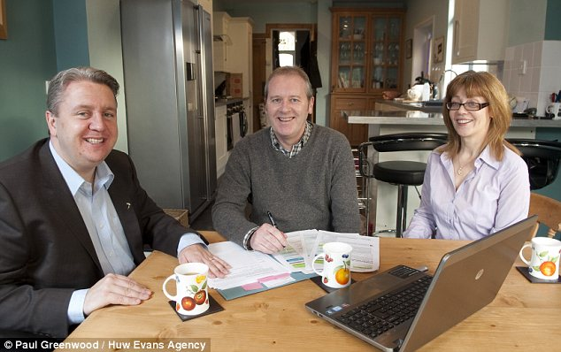 Bigger picture: Jo McGill and her husband Peter Lewis find they have more money to save since their adviser Craig Palfrey, left, began helping them