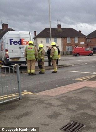 Firefighters survey the damage