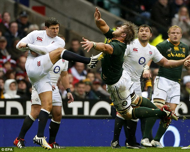 Clearing his lines: Ben Youngs gets a kick away despite the attentions of Duane Vermeulen