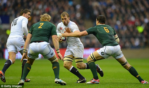 Hands up: Chris Robshaw is closed down by Adriaan Strauss (left) and Francois Louw