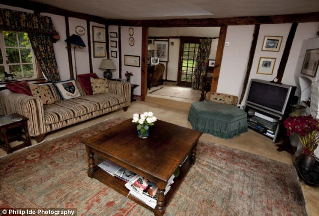 Family secret: The reception room on the bottom floor houses one of the cottage's two 'hidden staircases'