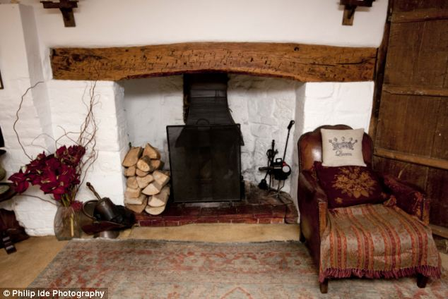 Home of Bunty: The fireplace in the sitting room of the three-bedroom Grade II listed cottage