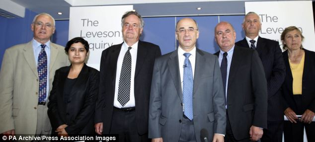 Lord Justice Leveson (centre) will publish the report next week after he and his assessors held an inquiry into culture practices and ethics of the press