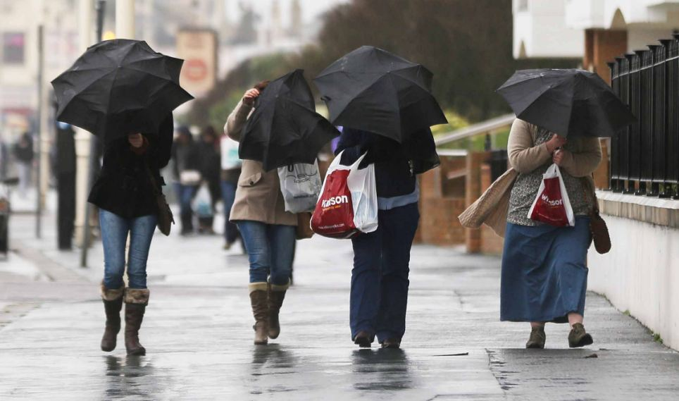 Wild winds: Bognor Regis suffered severe gales which swept along the Sussex Coast, leaving many residents to battle against the miserable conditions