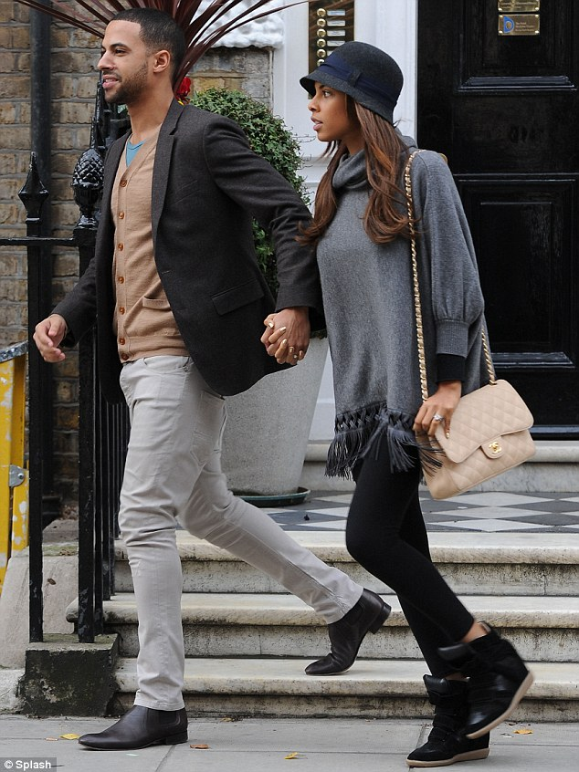Reunited: The couple are glad to be back in each other's company after spending most of their four-month marriage apart