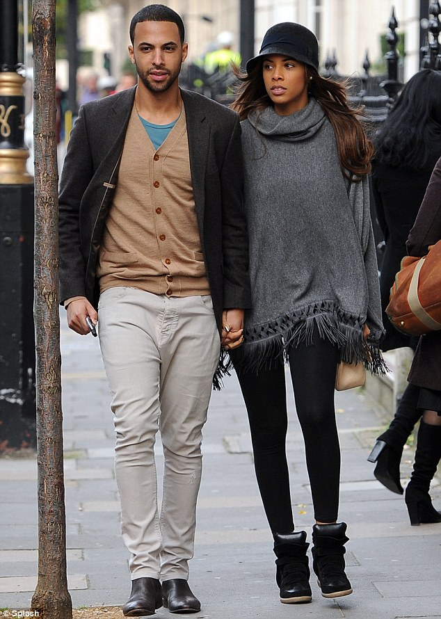 Starting a family: Pregnant Rochelle Humes and her husband Marvin running errands in London last week