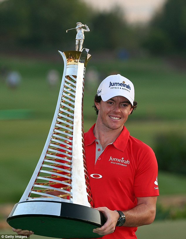 Size does matter: McIlroy gets to grips with the huge prize he scooped for winning the race to Dubai