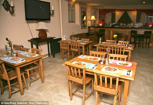 Cosy atmosphere: The interior of  the Cabbages and Condoms restaurant