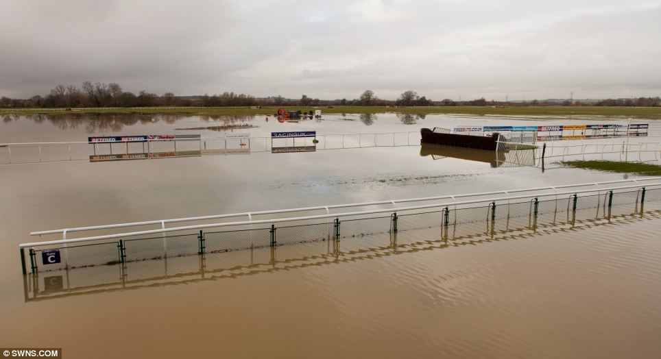 Heavy rain has left the fenns flooded as the River Ouse burst its banks around Huntingdon Racecourse in Huntingdon, Cambridgeshire on  Monday